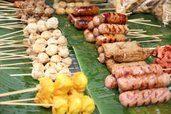 Thai style meat ball on grill. Grilled Meat Balls on banana leaf Stock Images