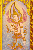 Thai-style murals. Thai-style murals on the door at temple of Thailand royalty free stock images