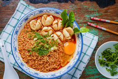Thai style noodle, noodle tom yum kung. With beef meatball on table. Thai food Royalty Free Stock Photo