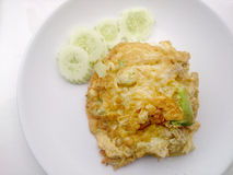 Thai-Style Omelet (Khai Jiao), Omelet with vegetables in white plate ...