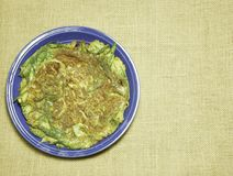 Thai-style omelette with herb on dish Hessian sackcloth woven ba stock photo