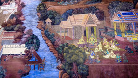 Thai style painting art old (1931) of Ramayana story on the temple wall of famous Wat Phra Kaew in Bangkok, Thailand. Royalty Free Stock Photo