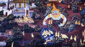Thai style painting art old (1931) of Ramayana story on the temple wall of famous Wat Phra Kaew in Bangkok, Thailand. Stock Photo