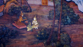 Thai style painting art old (1931) of Ramayana story on the temple wall of famous Wat Phra Kaew in Bangkok, Thailand. Royalty Free Stock Images