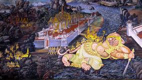 Thai style painting art old (1931) of Ramayana story on the temple wall of famous Wat Phra Kaew in Bangkok, Thailand. Stock Image