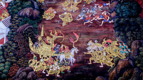 Thai style painting art old (1931) of Ramayana story on the temple wall of famous Wat Phra Kaew in Bangkok, Thailand. Royalty Free Stock Photos