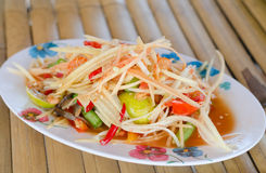 Thai Style papaya salad. Thai Style spicy papaya salad royalty free stock images