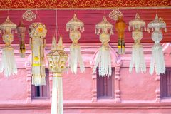 Thai style paper lanterns. Traditional perforated design northern Thai style paper lanterns hanging from the temple ceiling as relgious offerings, typically Stock Image