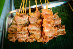 Thai style pork barbecue on banan leaf Stock Image