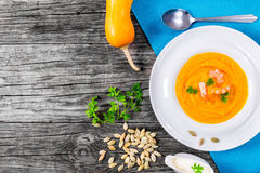 Thai-style Red Curry Pumpkin Soup With Prawns, view from above Stock Photos