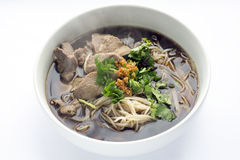 Thai Style Rice Noodles Soup with Beef. Thai Style Beef Rice Noodles Soup in Ceramic Bowl on White Fabric Background Royalty Free Stock Image
