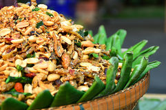 Roasted peanuts with herb spices. Thai style Roasted peanuts with herb spices Royalty Free Stock Image