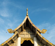 Thai Style Roof Top with Small Ring On Blue Sky. And Cloud Royalty Free Stock Photography