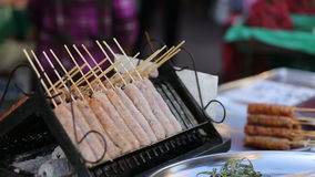 Thai style sausage grill on a stove stock video footage
