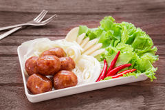 Thai style sausages and fresh vegetables on dish, Thai food Stock Photos