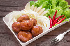 Thai style sausages and fresh vegetables on dish, Thai food. Thai style sausages and fresh vegetables on dish, (Thai food) stock photography