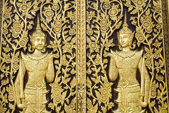 Thai style sculpture on temple wall Stock Image