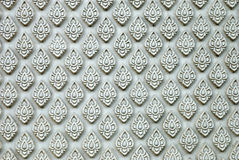Thai style sculpture on temple wall Stock Photography