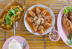 Thai style seafood with rice. On wooden table Stock Image