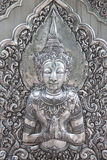 Thai style silver carving art on temple wall Royalty Free Stock Photos
