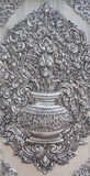 Thai style silver carving art on temple wall. Royalty Free Stock Photos