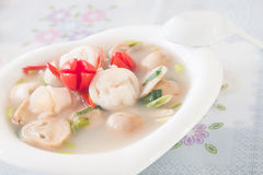 Thai style spicy soup,Tom Yum. With the squid and mushroom Stock Image