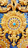 Thai style stucco texture on ceramic wall at temple. Traditional thai style with floral stucco texture on coloful ceramic wall at temple in Thailand Royalty Free Stock Image
