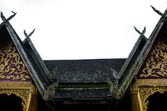 Thai style temple's roof stock photos