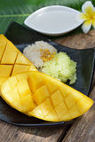 Thai style tropical dessert, glutinous rice eat with mangoes Royalty Free Stock Photography