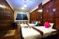 Thai style tropical hotel bedroom Stock Photos