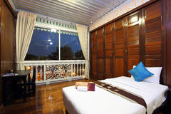 Thai style tropical hotel bedroom Royalty Free Stock Photography