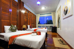Thai style tropical hotel bedroom Stock Photography