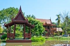 Thai style waterfront pavillian Stock Photos