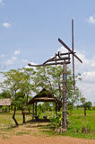 Thai style windmill with hut in countryside Royalty Free Stock Photography
