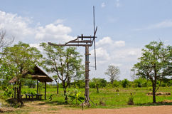 Thai style windmill with hut in countryside Royalty Free Stock Images