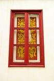 Thai style window. Red Thai style window on white wall Royalty Free Stock Photos