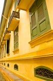 Thai style windows. Thai style window on the yellow wall Royalty Free Stock Photos