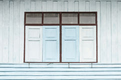 Thai style windows and old wood shutters Stock Photo