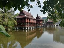 Thai style wooden house near the river. With blue sky royalty free stock photos