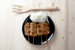 Thai-styled grilled pork and sticky rice. It's among most popular street foods in Thailand Stock Image