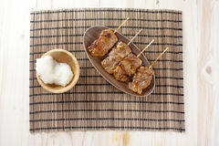 Thai-styled grilled pork and sticky rice. It's among most popular street foods in Thailand Royalty Free Stock Images