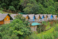 Thai styled wooden hut with thatched roof surrounded by forest i Royalty Free Stock Images