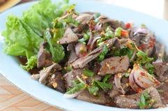 Thai sweet liver salad on dish Stock Photo