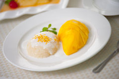 Thai Sweet Sticky Rice with Mango. This is very simple but tropical des- sert Royalty Free Stock Photography