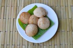 Thai sweetmeat grilled coconut cream hotcake called Kanom Krok. On dish Stock Image