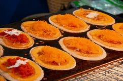 Thai sweetmeat Khanom Buang (a kind of filled pancake) Stock Photo