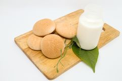 Thai sweetmeat with milk on wood dish for breakfast or breaktime. Thai sweetmeat made of flour, egg and sugar as sweet taste. Eat with milk, tea or coffee so Royalty Free Stock Images