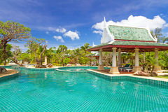 Thai swimming pool scenery. Tropical garden scenery with swimming pool in Thailand Stock Photography