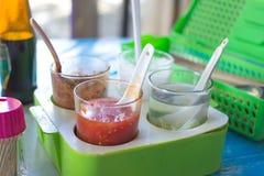 Thai symple cuisine in general thai restaurant. Thai symple cuisine often include vinegar, chili and sugar in thai restaurant Stock Photos