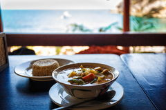 Thai tasty soup. Thai soup and rice on table in restaurant in Thailand stock photos